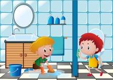 Dois meninos que limpam o toalete Imagem de Stock Royalty Free