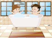 Dois meninos que tomam o banho junto na cuba Foto de Stock