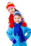 Dois miúdos na roupa do inverno Foto de Stock Royalty Free