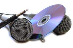Dois microfones e CD prendidos pretos do karaoke. Imagem de Stock