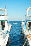Dois navios e pouco barco Fotografia de Stock