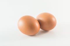 Dois ovos No fundo branco Foto de Stock