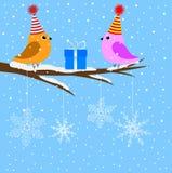 Dois pássaros que sentam-se em um ramo de uma árvore ilustração do vetor