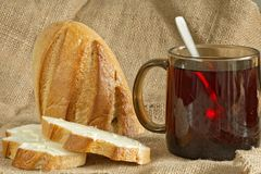 Dois pães com o copo do creme ácido na lona ensacam Imagem de Stock Royalty Free