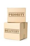 Dois pacotes da caixa com impressão da entrega da prioridade Fotos de Stock