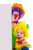 Dois palhaços da menina que prendem a placa vazia do texto Imagens de Stock Royalty Free