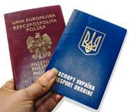 Dois passaportes na mão Imagens de Stock Royalty Free