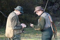 Dois pescadores que verific a engrenagem Imagem de Stock Royalty Free