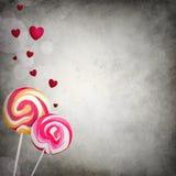 Dois pirulitos com corações de flutuação Imagem de Stock