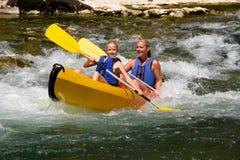 Dois povos na canoa fotografia de stock royalty free
