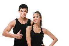 Dois povos sportive positivos no sportswear preto imagem de stock royalty free