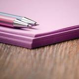 Dois punhos na pilha de papel roxo Fotografia de Stock Royalty Free