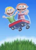 Dois rapazes pequenos têm o divertimento em uma caricatura de Digitas do carro Fotografia de Stock Royalty Free