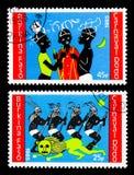 Dois selos postais impressos em Burkina Faso do serie de Dodo Carnival, cerca de 1986 imagem de stock