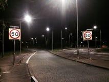 Dois 50 sinais do MPH na estrada Fotos de Stock