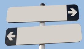 Dois sinais que apontam no sentido oposto com espaço da cópia e azuis Imagem de Stock