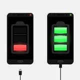 Dois smartphones pretos que carregam com os micro cabos do usb Imagem de Stock