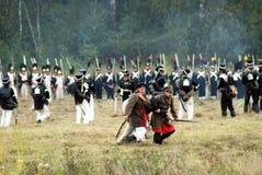 Dois soldados que levam um mais sodlier ferido Foto de Stock Royalty Free