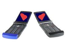Dois telefones de pilha com corações vermelhos Fotos de Stock Royalty Free