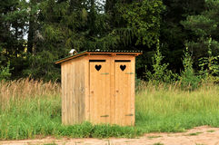 Dois toaletes no país Foto de Stock Royalty Free