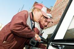 Dois trabalhadores com broca Imagem de Stock Royalty Free