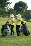 Dois transportadores em um campo de golfe Foto de Stock Royalty Free