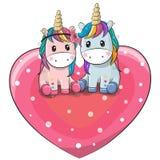 Dois unicórnios bonitos estão sentando-se em um coração ilustração royalty free