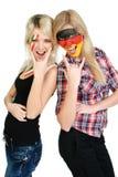 Dois ventiladores de esportes com faces causadas dor Foto de Stock Royalty Free