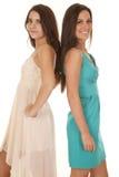Dois vestidos das mulheres de volta à parte traseira Imagens de Stock Royalty Free