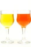 Dois vidros da cor de água com amarelo e a laranja Imagens de Stock Royalty Free