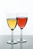 Dois vidros enchidos no branco Imagens de Stock Royalty Free