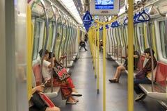 Dojeżdżający wśrodku pociągu MTR Hong Kong popularny sposób transport w mieście Fotografia Stock