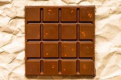 Dojny czekoladowy bar z dokrętkami Zdjęcie Royalty Free