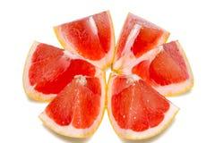 Dojrzała połówka różowa grapefruitowa cytrus owoc odizolowywająca na białym tle z ścinek ścieżką Obraz Stock