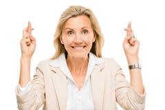 Dojrzały biznesowej kobiety mienie dotyka krzyżujący odosobnionego na bielu zdjęcie stock