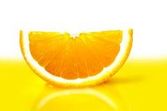 Dojrzały pomarańczowy plasterka zakończenie Obrazy Stock