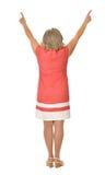 Dojrzała kobieta w menchii sukni Zdjęcia Royalty Free
