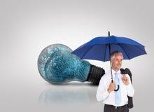 Dojrzały biznesmen trzyma parasol Zdjęcie Stock