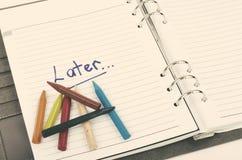 Dojutrkostwa i pilności pojęcie z handwriting formułuje Opóźnionego na białej książce zdjęcie royalty free