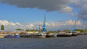 `Dok noord` harbor in Ghent with house boats and industrail cranes Stock Images