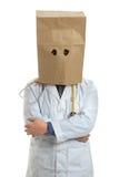 Doktor över huvudet Wearing Paper Bag Royaltyfria Foton