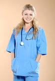 Doktor. Doctor the woman in a uniform with a smile Royalty Free Stock Image