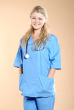 Doktor. Doctor the woman in a uniform with a smile Royalty Free Stock Photo
