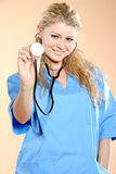 Doktor. Doctor the woman in a uniform with a smile Stock Photography
