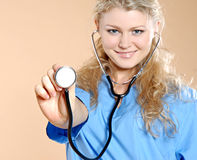 Doktor. Doctor the woman in a uniform with a smile Stock Image