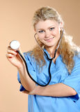 Doktor. Doctor the woman in a uniform with a smile Stock Photo