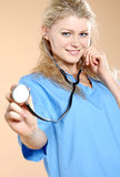 Doktor. Doctor the woman in a uniform with a smile Royalty Free Stock Images