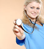 Doktor. Doctor the woman in a uniform with a smile Stock Photos