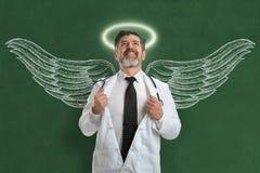 Doktor With Angel Wings och gloria Fotografering för Bildbyråer