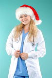 Doktor - christmas. Doctor the woman in a uniform with a smile Royalty Free Stock Photos